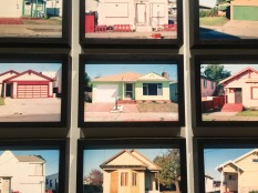 Close up of Real Estate Photographs by Henrey Wessel