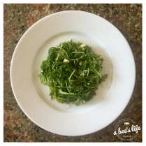 Plated little arugula salad.