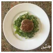 Jucy Lamb Lucy on a little arugula salad.