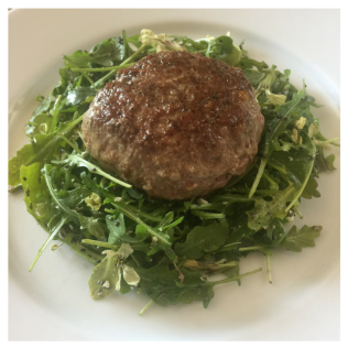 Jucy Lamb Lucy on a little arugula salad. Ready to eat!