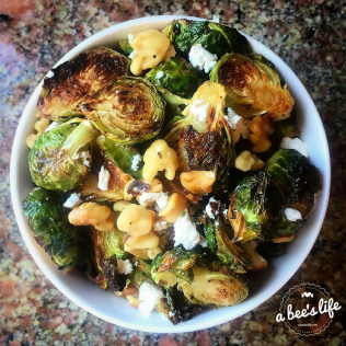 Roasted Brussels sprouts with walnuts and goat cheese.