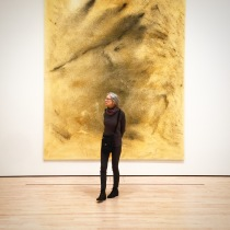 Woman in front of painting at the SF MoMA