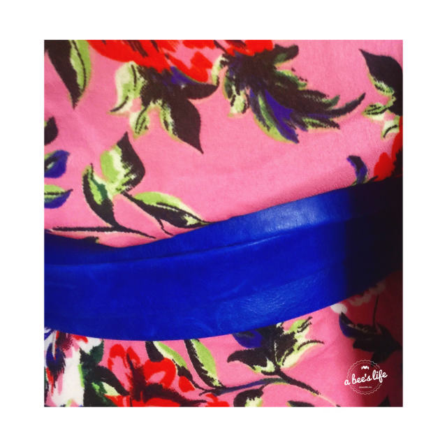blue leather wrap belt on a pink floral dress